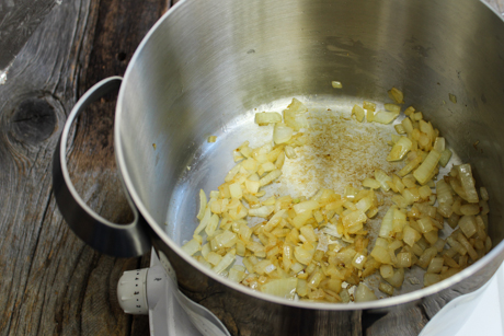 4. Fry onions in a large pot over medium-high heat with vegetable oil until cooked. About 5-7 minutes.