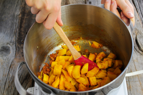 7. Once pumpkin is cooked return pot to medium-high heat and add pumpkin to the onion mixture.