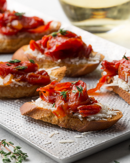 Crostini with tomato jam and cheese on a platter