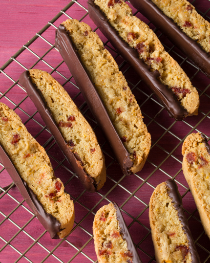 Chocolate dipped biscotti on a wire cooling rack