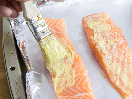 Place salmon fillets on prepared baking sheet, brush with an even amount of mustard. Divide sugar mixture between the tops of each fillet, and press it until it adheres to mustard.