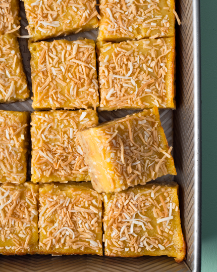 Cut up tropical bars with coconut crust and mango filling