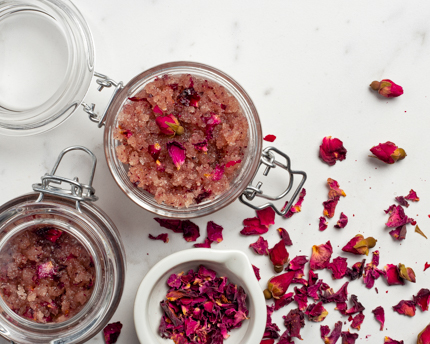 Jars of rose petals and rosewater sugar scrub with petals