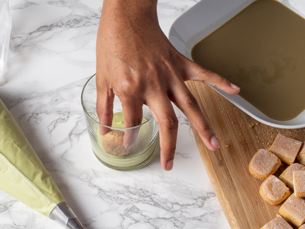 Placing a layer of ladyfinger pieces in mascarpone cream