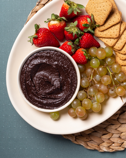 Graham crackers, fruits and a bowl of chocolate hummus