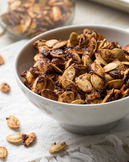 Roasted pumpkin seeds with brown sugar and seasoning in a bowl