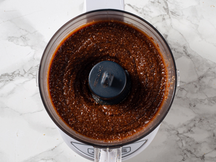 Toasted sesame seeds, cocoa, and oils fully processed in a food processor