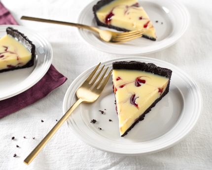 White Chocolate Raspberry Swirl Tart with a Dark Chocolate Crust