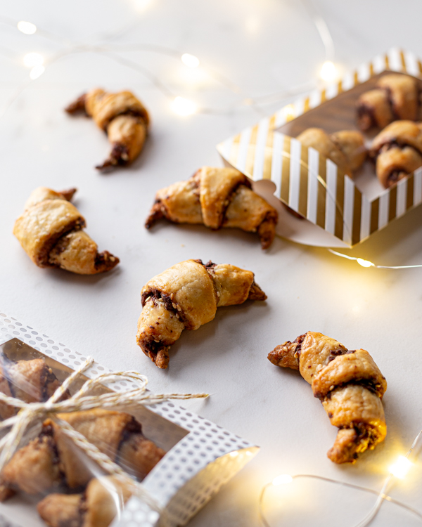 Chocolate tahini rugelach crescents being packaged up as gifts
