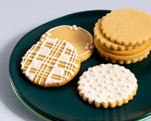 Plain sugar cookies on a green plate