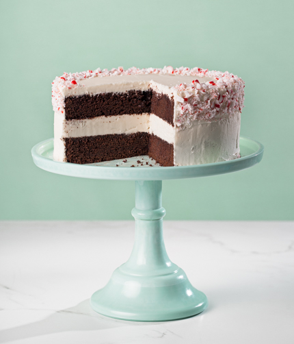 Peppermint Chocolate Layer Cake on blue cake plate