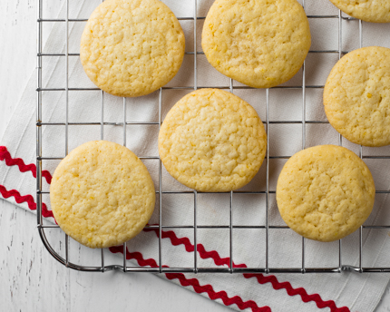 Lemon sugar cookies on a wire cooling rack